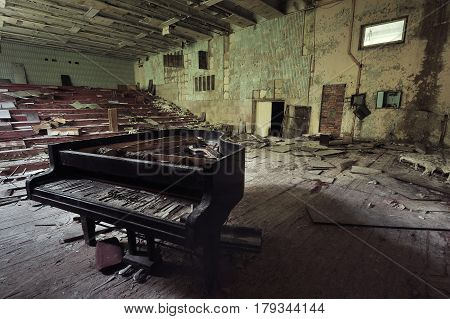 Old Ruined Grand Piano In A Concert Hall In The City Of Pripyat: Collapsed Rows Of Chairs, Green Wal