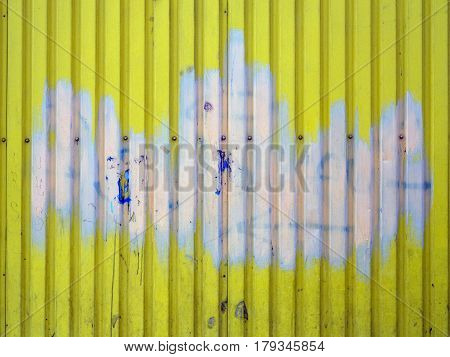 Yellow With Pink Abstract Stain Shaped Like A Crown Metal Wall Background Texture With Screws In The