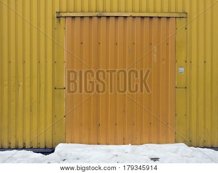 Yellow Metal Strips Wall Relief In The Middle Of A Dark Yellow Square Opening Under The Gate, Yellow
