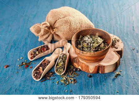 Dry herbs for making tea. Healthy herbal tea on a blue background