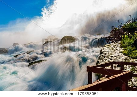 Close up of water rushing over Niagara Falls Ontario Canada New York USA