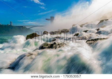 Close up of water rushing over Niagara Falls Ontario Canada New York USA