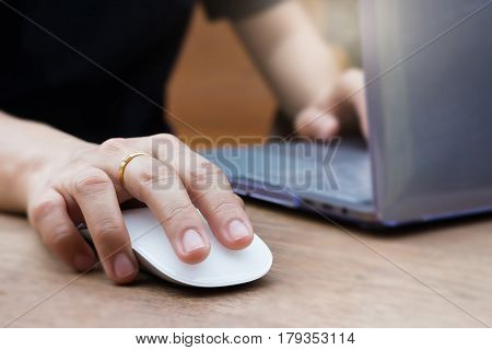 Woman Hands Using Laptop Touchpad stock photo