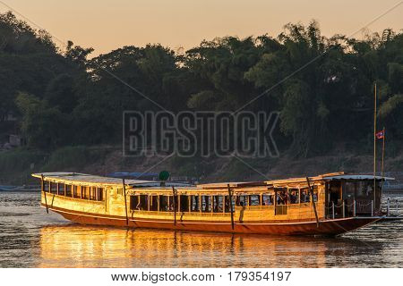 Tourist boat on the Mekong river, Luang Prabang, Laos