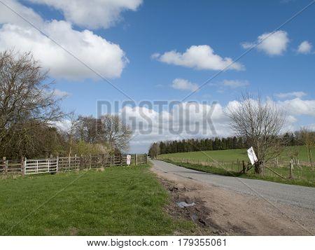 Single lane road through English countryside and farmland