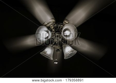 Watching the ceiling fan spin around and captured the motion of the fan blades