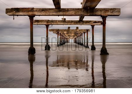 Long exposure of the Costanera in Punta Arenas, Chile, an abandoned dock and pier
