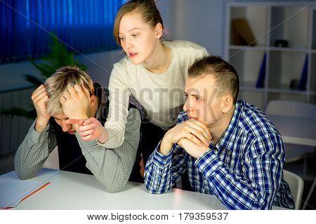 Team of three people do boring job