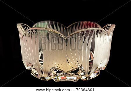 vase from crystal with red and green illumination on a black background