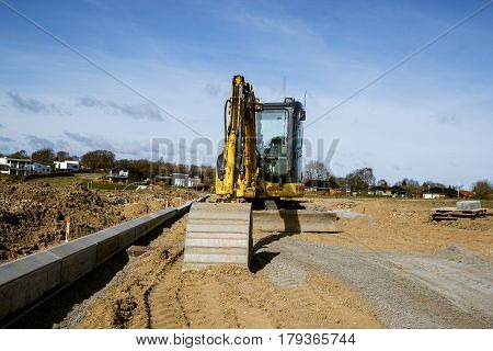 Yellow Excavator Digging On A Construction Site
