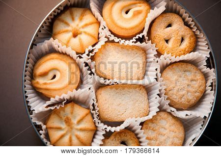 close up of danish butter cookies in their box