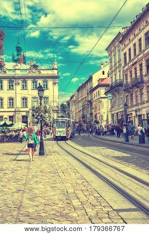 Lviv Ukraine - August 15 2016: Historic center of Lviv on the corner of Market Square. Vintage toned