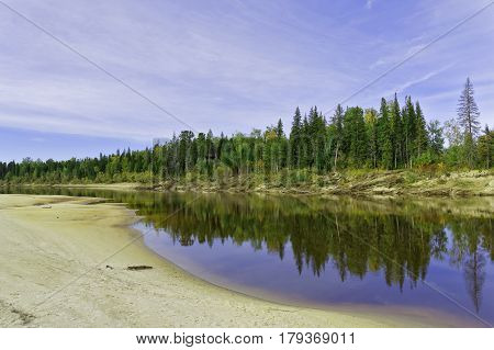 Autumn beach taiga river Big Yugan in Siberia