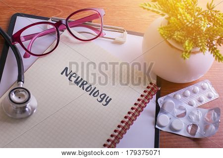Stethoscope on note book with Neurology words as medical concept