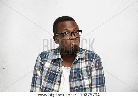 I Have No Idea. Portrait Of Confused Young African American Male In Glasses Shrugging Shoulders Havi