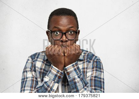 Funny Pop-eyed Afro American Student In Eyewear Feeling Nervous And Scared Before Exams At College,