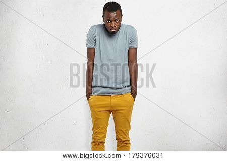 Shy Handsome Young African American Man Feeling Embarassed Or Uncomfortable, Shrugging Shoulders, Ke