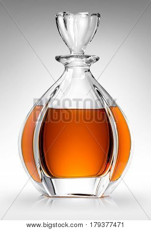 Carafe with whiskey on a gray background