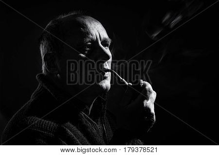 Black and white portrait of a caucasian man with tobacco pipe
