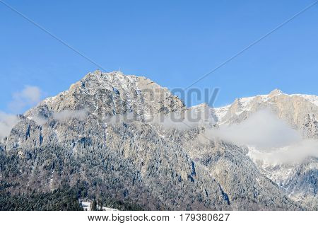 Romanian Carpathian Mountains, Bucegi Range With Clouds, Snow And Fog, Winter Time Landscape