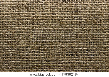 Brown jute fabric natural canvas texture background.