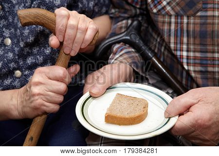 Old Couple. Poverty And Bread