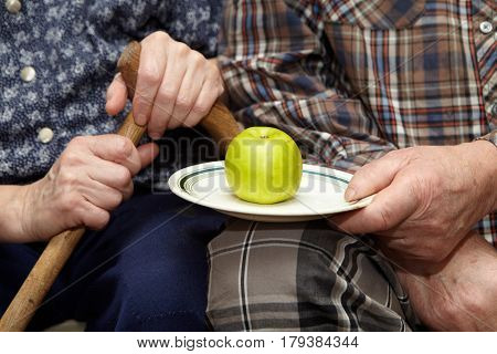 Old Couple. Poverty And Apple