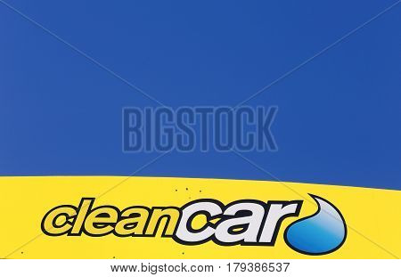 Salem Sweden - May 29 2014: Close up of the logo on the side of the roof of the Clean Car unmanned car washes in Sweden for self-service against a blue sky. This one is located in Salem south of Stockholm.