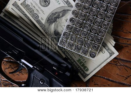 Dollar notes and gun, black pistol, mafia inspiration