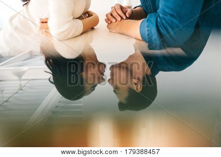 Detachment of a young beautiful couple sitting and talking. Conceptual image of communication between a man and a woman. Interaction between people. poster