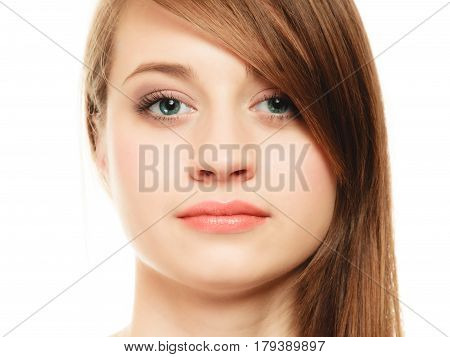 Female hairstyle. Portrait of girl with makeup and long bang covering her eye isolated on white.