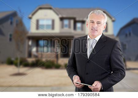 man real estate agent holding buy, sell and rent offers on residential house background