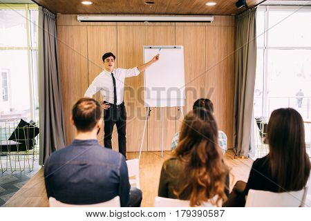 Web Designers Standing At Office Planning Website Layout On Flipchart