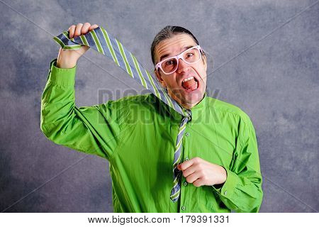 Stressed Man In Green Shirt Pink Glasses Strangle With Necktie