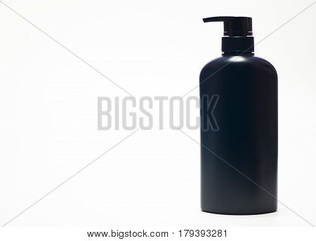 Black plastic bottle White background. Flask. Isolated.