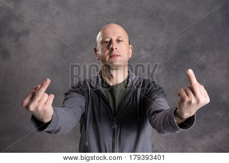 Baldheaded Man Showing Middle Finger