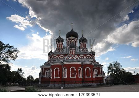 Orthodox Church of the Resurrection against the cloudy sky in Borisov, Belarus.