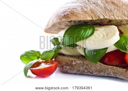 Ciabatta With Mozzarella, Tomato And Basil Isolated On White
