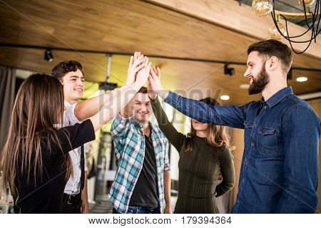 Happy People High Fiving Each Other At Meeting Or Seminat Of Teamwork In Office