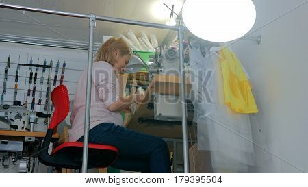 Professional tailor, fashion designer working at sewing studio. Fashion and tailoring concept