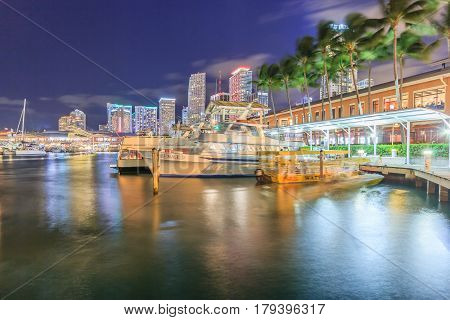 MIAMI, FLORIDA/USA - DECEMBER 31, 2016: Bayside Marketplace at night on December 31, 2016 in Miami Florida. It is a festival marketplace and the top entertainment complex in Downtown Miami attracting 15M people annually.