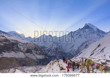 ANNAPURNA NEPAL - APRIL 14 2016 : Prayer flags and snow mountain of Himalaya Annapurna base camp with Machapuchare peak in background Nepal