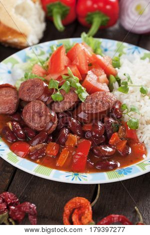 Rice and red kidney beans with slices of pork sausage