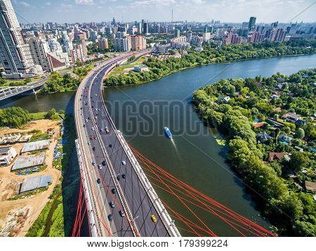 MOSCOW, RUSSIA - AUGUST 6, 2016: Aerial view of Moscow with Moskva River from a modern cable-stayed bridge.