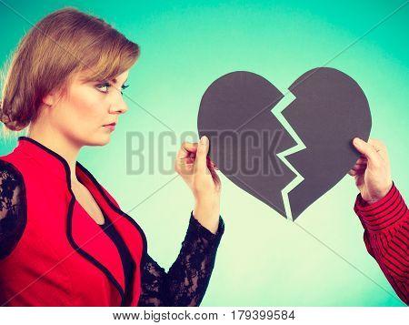 Couple With Broken Heart Breaking Up.