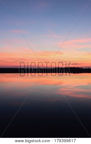 Hydroelectric power plant Cierny Vah. Sunrise in Slovakia. Multicolor clouds over water level.