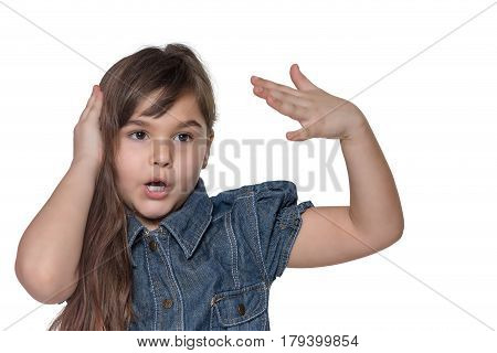 Portrait of emotionally gesticulating brunette long haired little girl isolated on the white background. The girl is holding her head with one hand and by the other hand is gesturing.