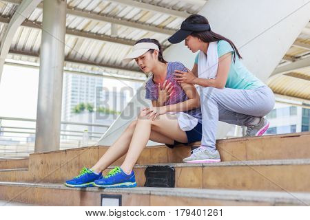 Sport girl try to help her friend who having symptomatic chest pain.Myocardial infarction