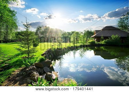 Wooden bathhouse near lake in the evening