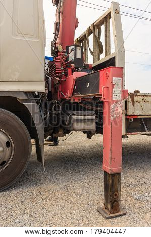 Close up of crane truck hydraulic control. Mechanical levers of switching on control panel of lifting mechanism.